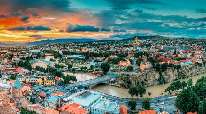 Tbilisi, Georgia. Panorama Cityscape Of Summer Old Town. Metekhi Church Of Assumption In Historic Neighborhood Of Tbilisi During Beautiful Sunrise. Central Part Of City With Famous Landmarks.