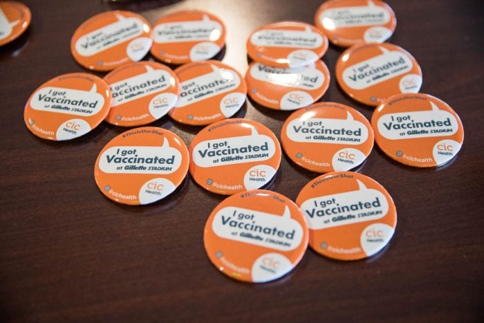 FOXBOROUGH, MA - JANUARY 15:  Pins for people who have been vaccinated at Gillette Stadium's vaccination site on January 15, 2021 in Foxborough, Massachusetts. First responders and healthcare workers will be first to recieve the vaccinations at the stadium, starting with around 300 people per day, but advancing to thousands per day soon after.  (Photo by Scott Eisen/Getty Images)